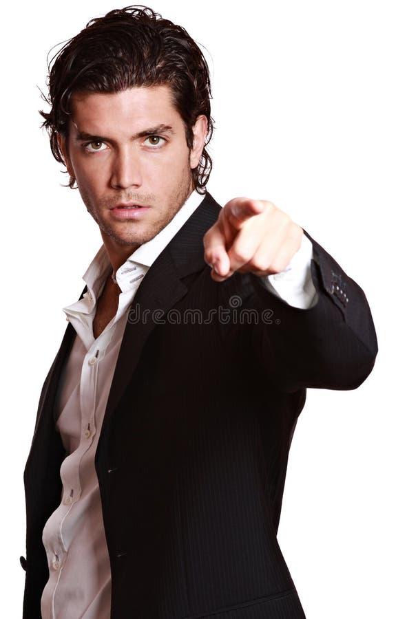 Homme bel dirigeant le doigt à l'appareil-photo photos stock