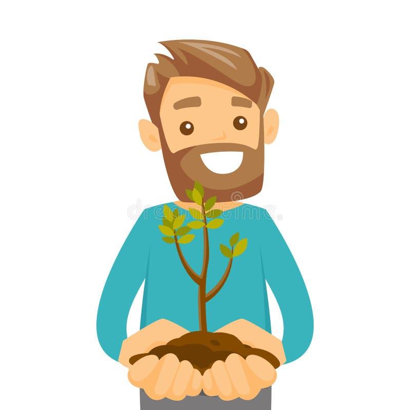 Homme blanc caucasien tenant la plante verte dans le sol illustration libre de droits