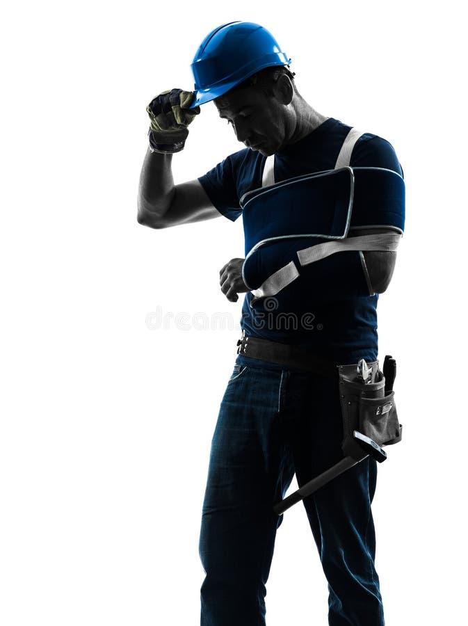 Homme blessé de travailleur manuel avec la silhouette de désespoir d'accolade de blessure photo stock