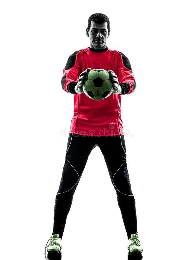 Homme caucasien de gardien de but de footballeur tenant la silhouette de boule photos libres de droits