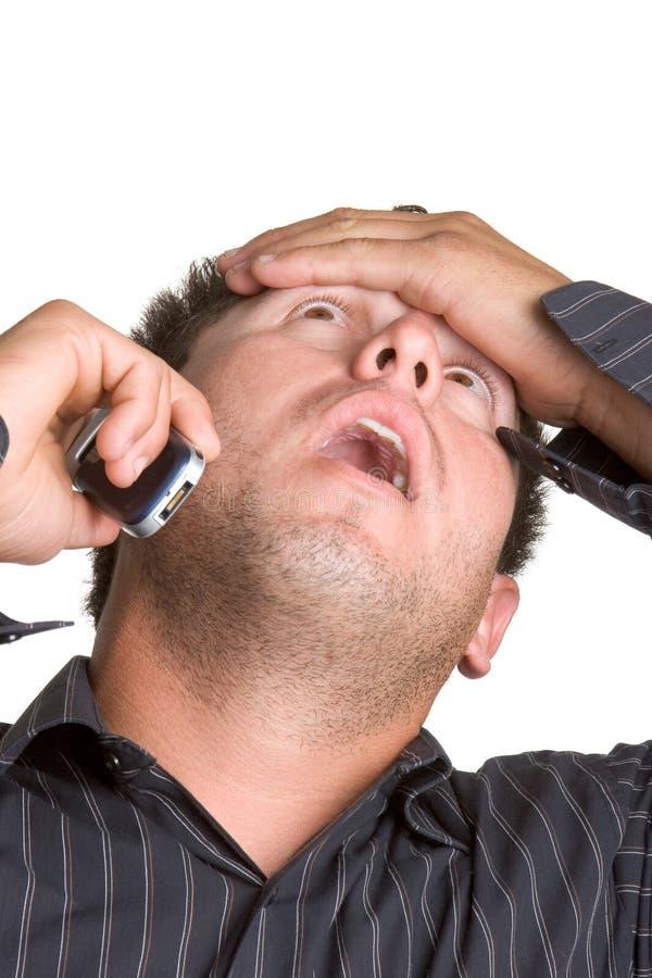 Homme choqué de téléphone images stock