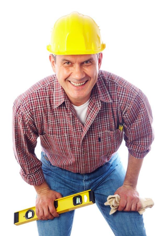 Homme-constructeur beau de sourire image libre de droits