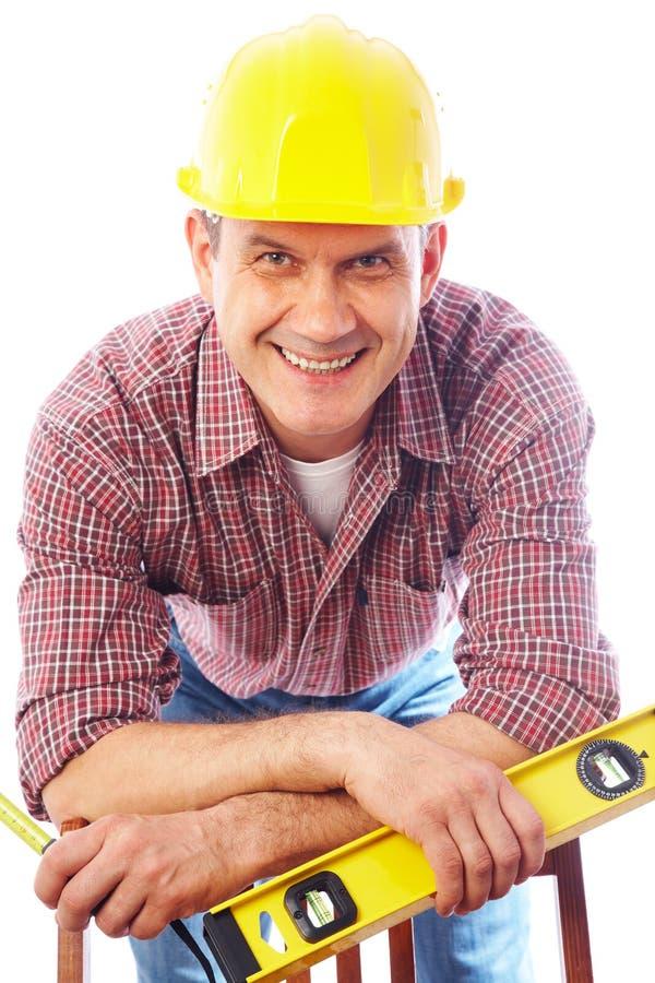 Homme-constructeur beau de sourire image stock