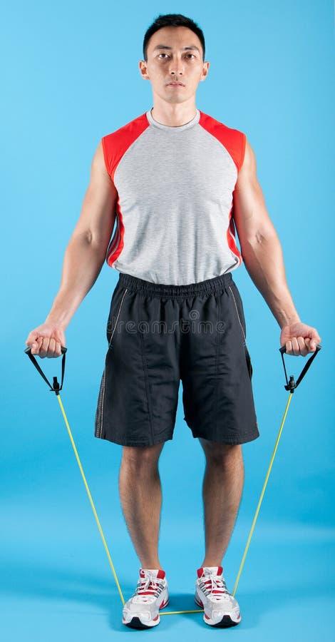 Homme convenable avec la bande de bout droit d'exercice images libres de droits