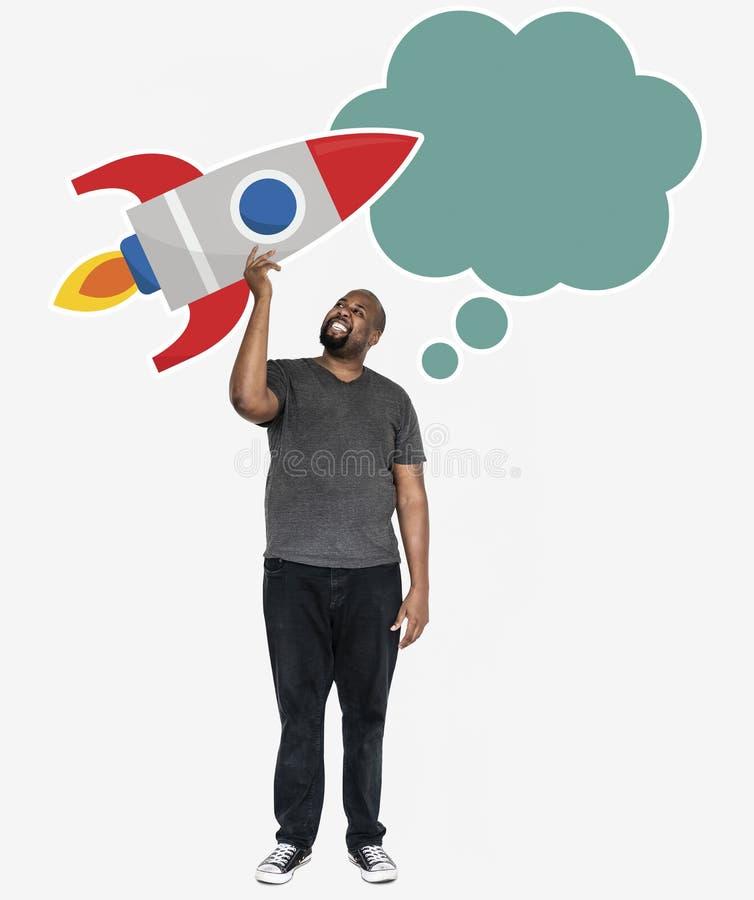 Homme créatif avec un symbole de lancement de fusée image libre de droits