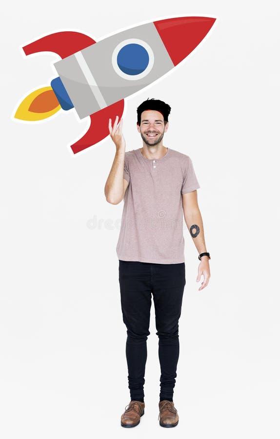 Homme créatif avec un symbole de lancement de fusée photos stock