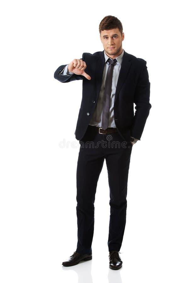 Homme déçu d'affaires avec le pouce vers le bas photos stock