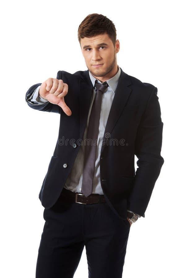 Homme déçu d'affaires avec le pouce vers le bas photographie stock libre de droits