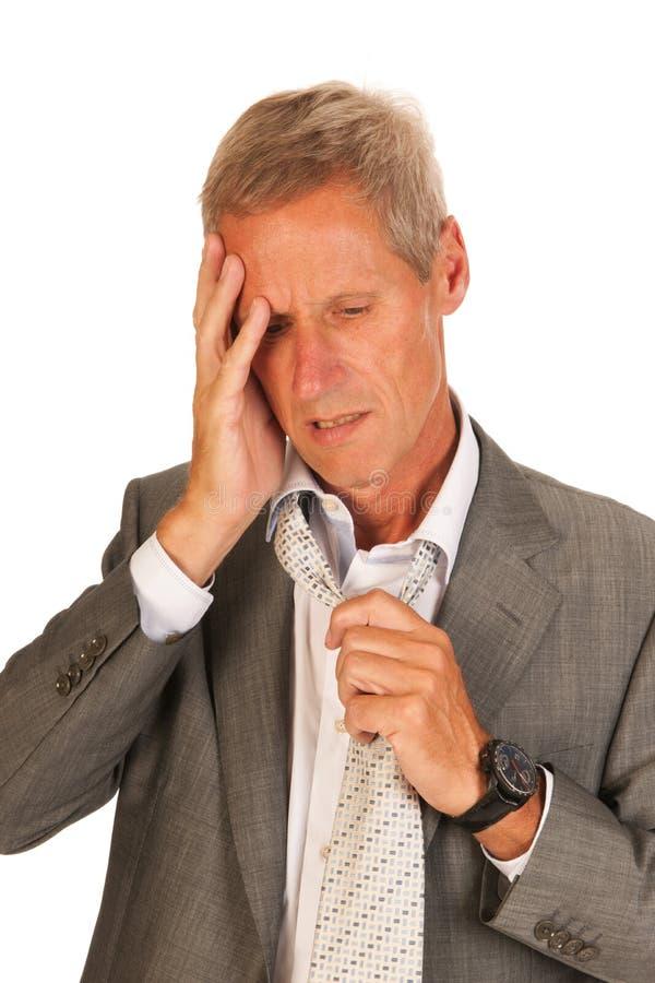 Homme déprimé d'affaires photographie stock