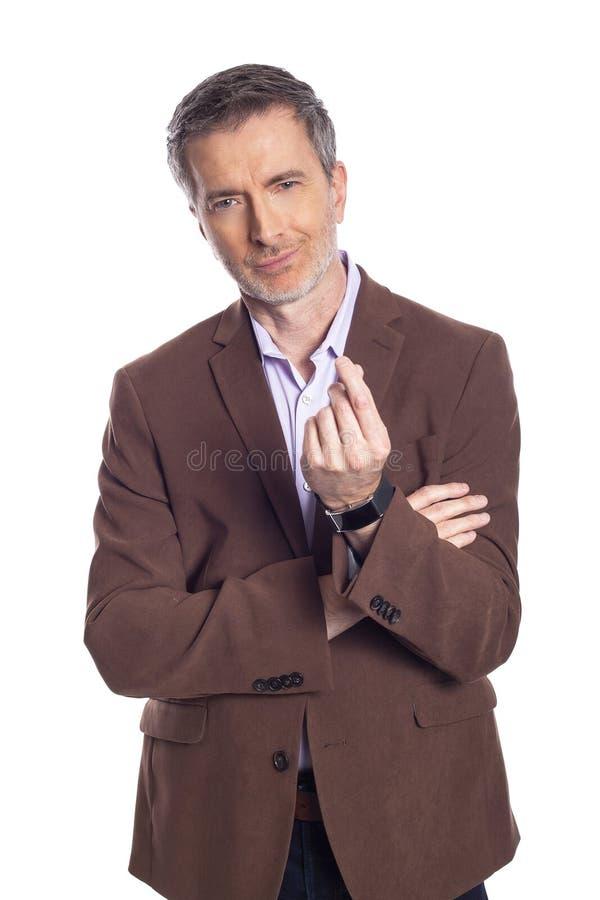 Homme d'affaires âgé moyen Doing un geste d'argent image stock