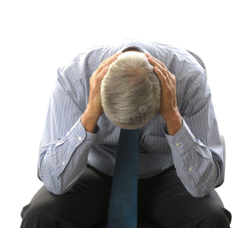 Homme d'affaires âgé moyen doublé au-dessus dans des mains photos libres de droits