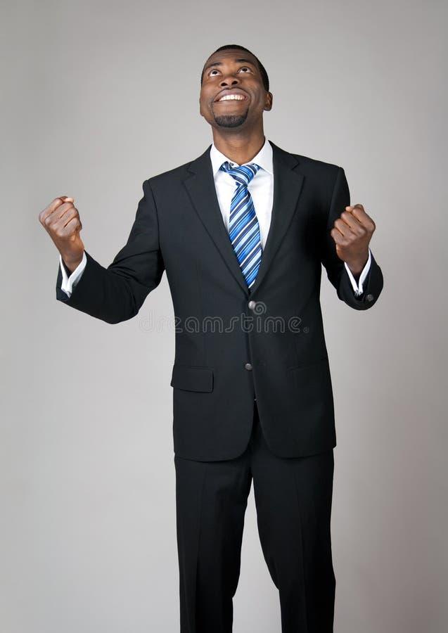 Homme d'affaires émotif priant dans l'espoir photographie stock