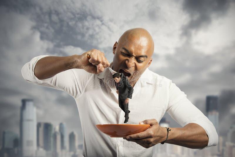 Homme d'affaires affamé image stock