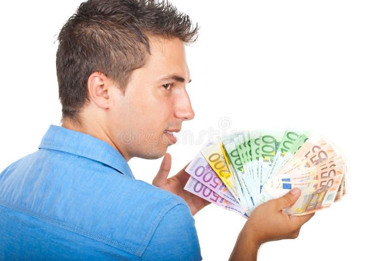 Homme d'affaires affichant l'argent photos stock