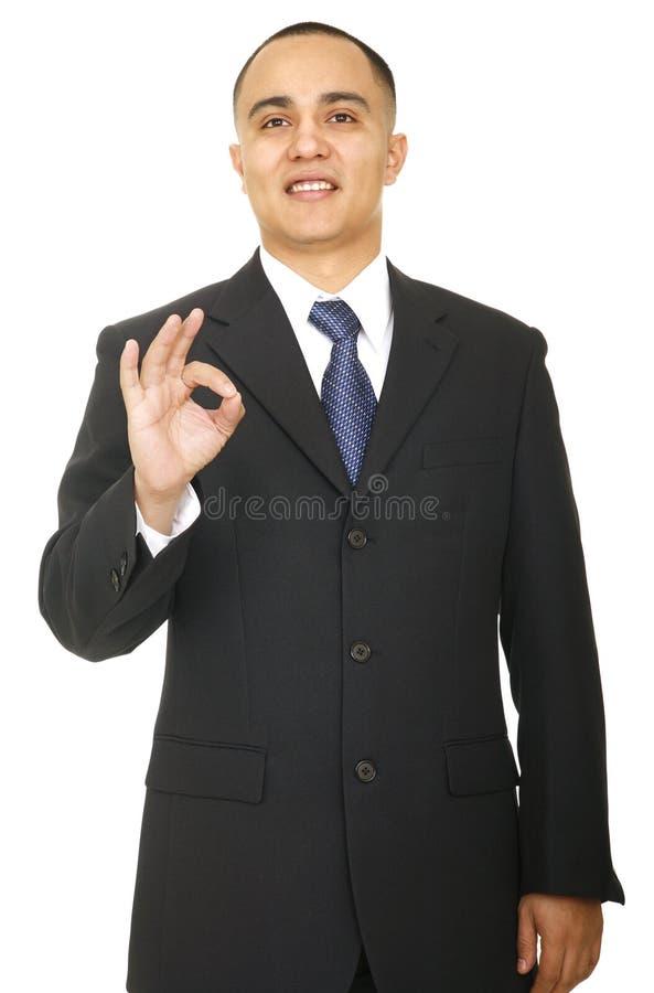 Homme d'affaires affichant le signe en bon état 2 image libre de droits