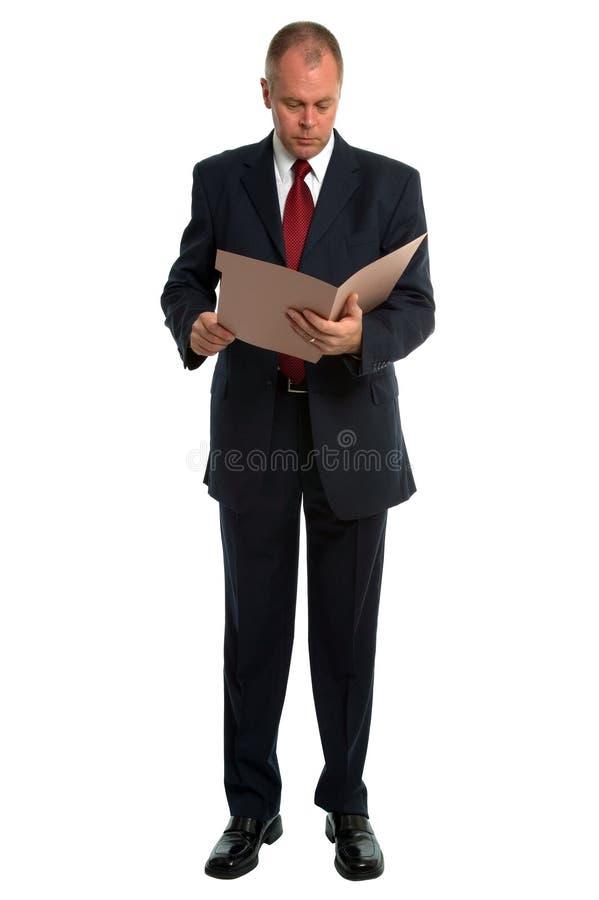 Homme d'affaires affichant un fichier photos libres de droits
