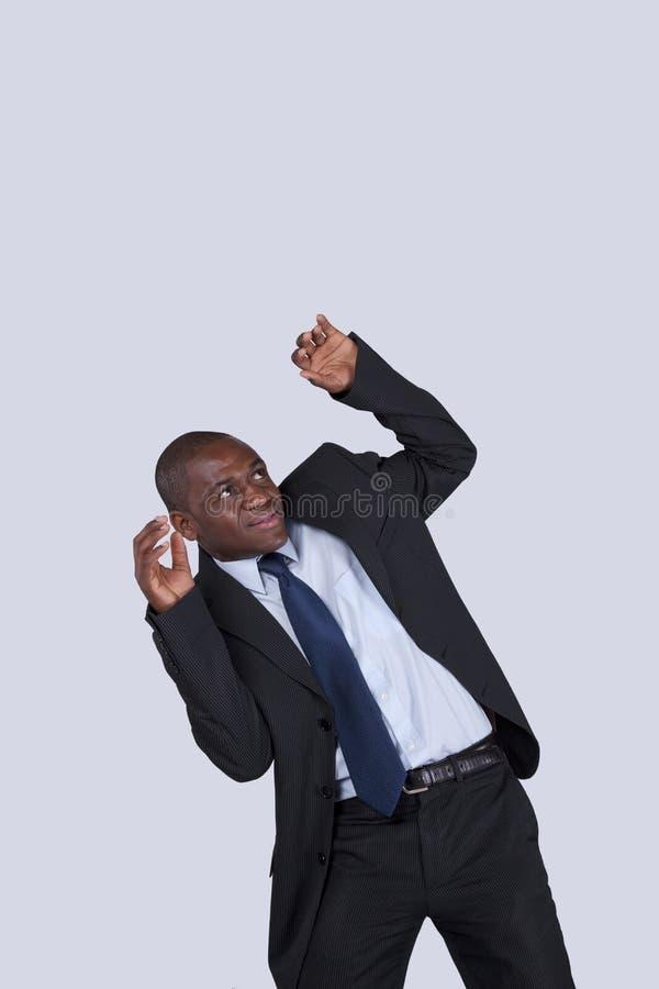 Homme d'affaires africain avec crainte images libres de droits