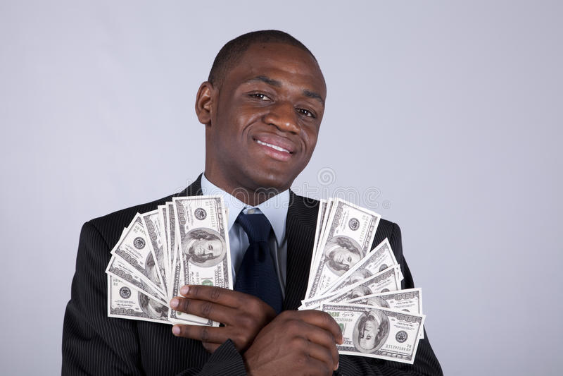 Homme d'affaires africain riche images stock