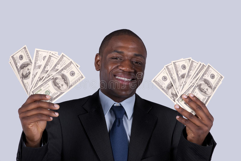 Homme d'affaires africain riche image stock