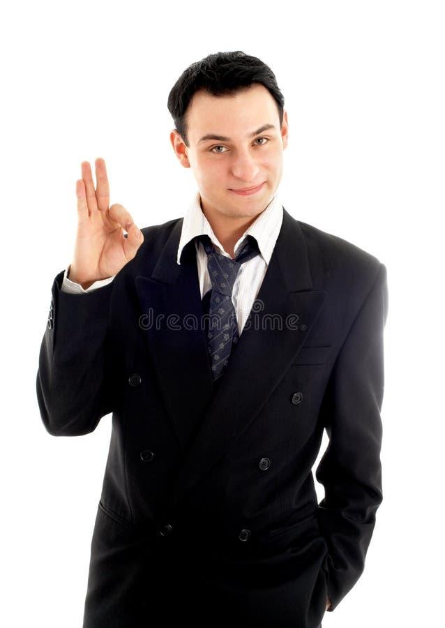Homme d'affaires amical affichant le signe en bon état images stock