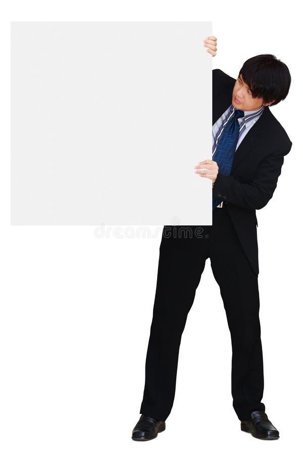 Homme d'affaires asiatique affichant l'enseigne blanc image stock