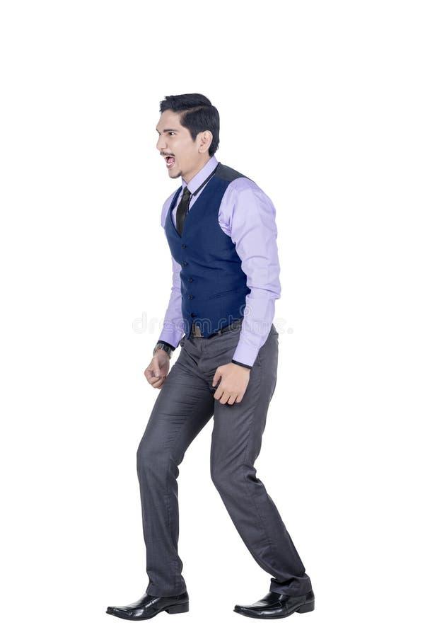 Homme d'affaires asiatique expressif dans la position formelle de costume photos libres de droits