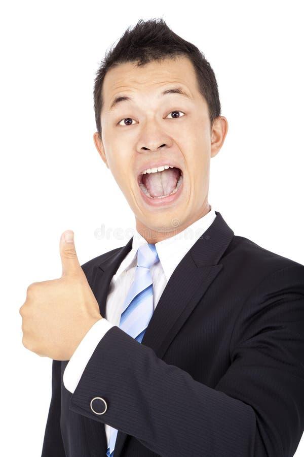 Homme d'affaires asiatique heureux avec le pouce vers le haut photo libre de droits