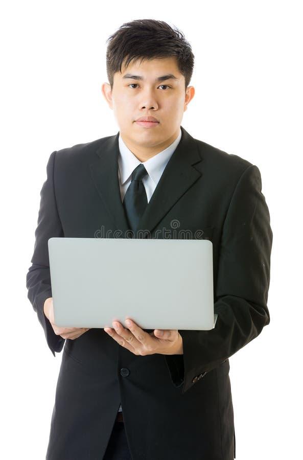 Homme d'affaires asiatique utilisant l'ordinateur portable photographie stock libre de droits