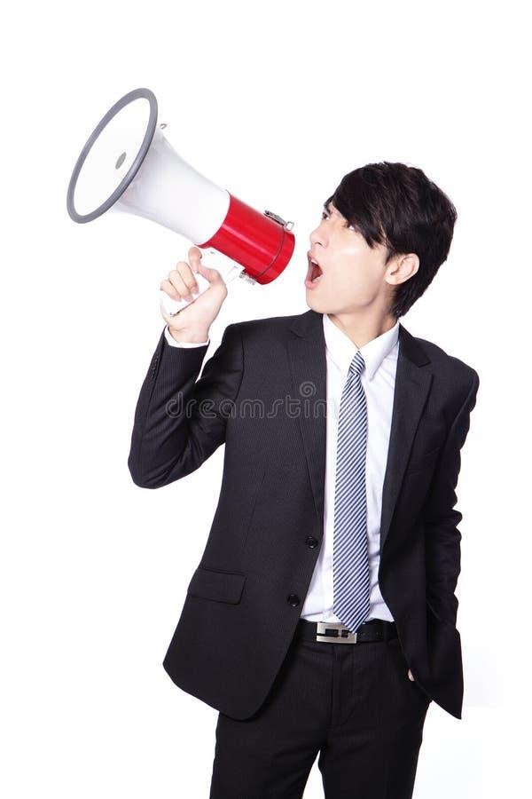 Homme d'affaires asiatique utilisant le corne de brume photographie stock