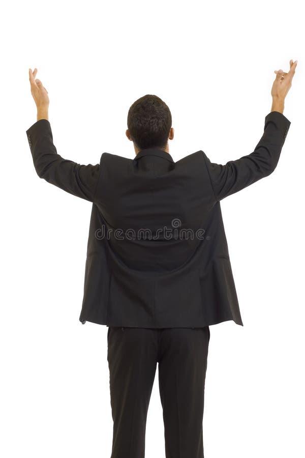 Homme d'affaires atteignant à l'extérieur avec ses mains images libres de droits