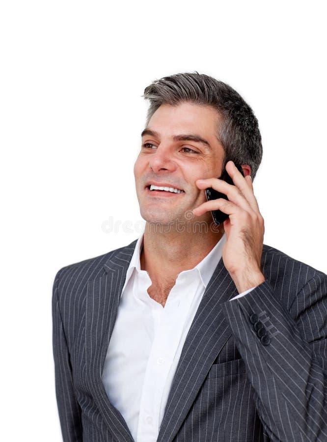 Homme d'affaires attirant au téléphone photo stock