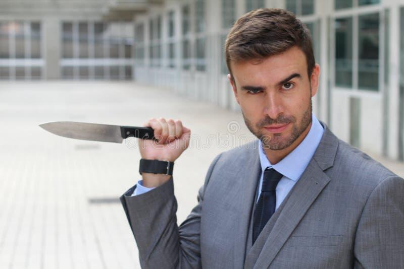 Homme d'affaires avec des comportements psychopathes images libres de droits