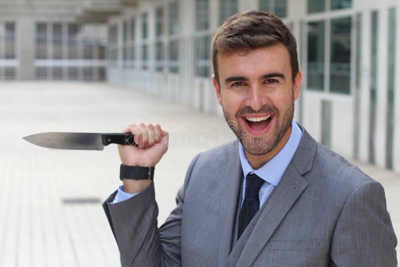 Homme d'affaires avec des comportements psychopathes images stock