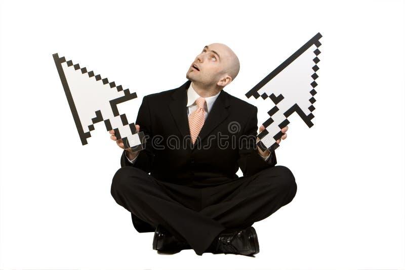 Homme d'affaires avec des flèches indicatrices photo libre de droits