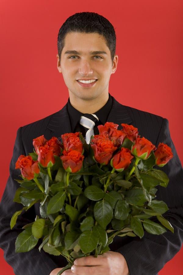 Homme d'affaires avec des fleurs images stock