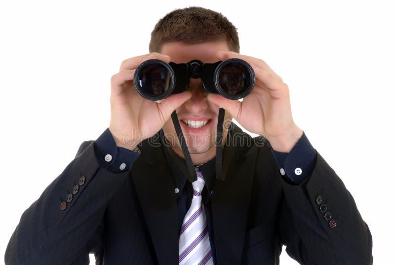 Homme d'affaires avec des jumelles photographie stock