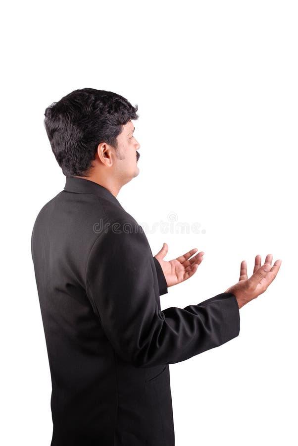 Homme d'affaires avec des paumes vers le haut images stock