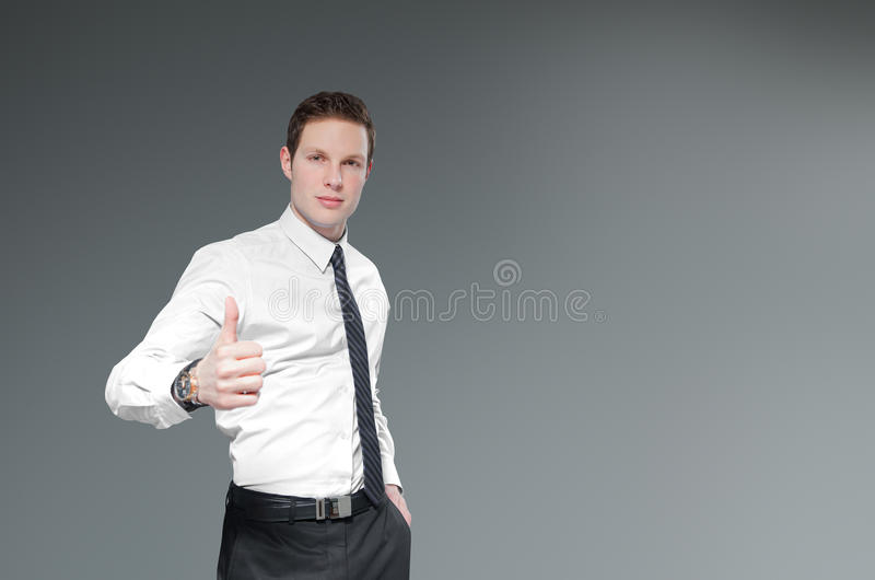 Homme d'affaires avec des pouces vers le haut. photo stock