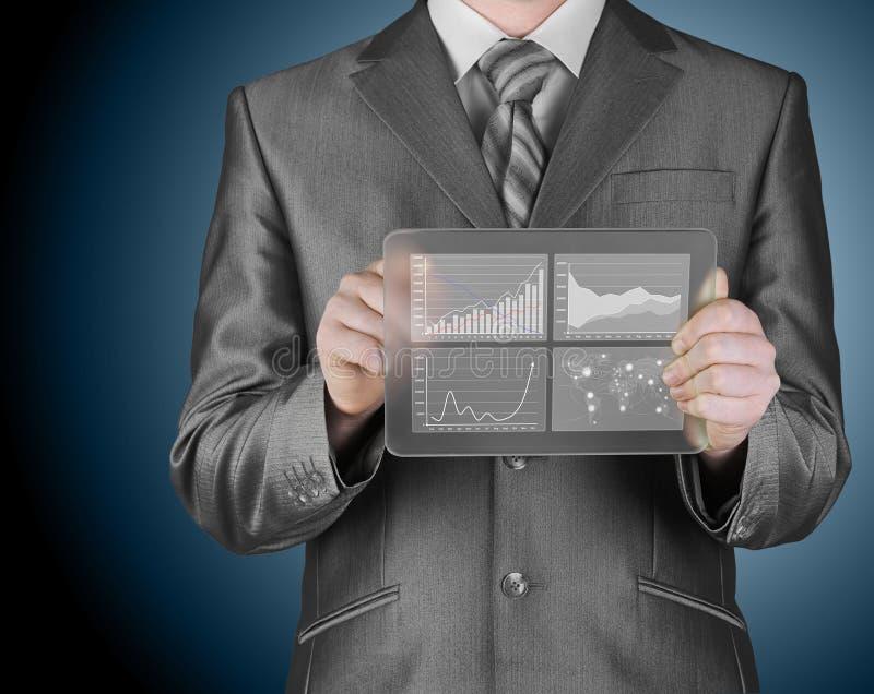 Homme d'affaires avec des symboles financiers photographie stock