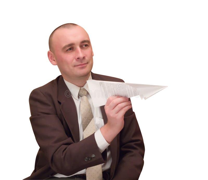 Homme d'affaires avec l'avion de papier. photographie stock libre de droits