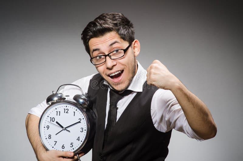 Homme d'affaires avec l'horloge image libre de droits