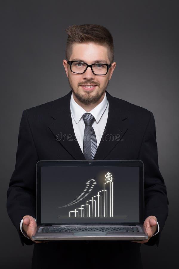 Homme d'affaires avec l'ordinateur portatif images stock