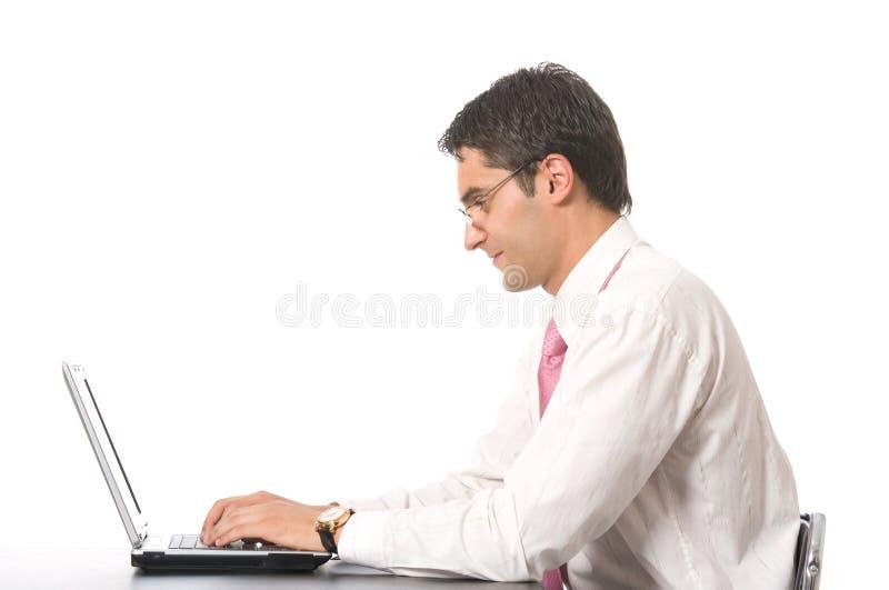 Homme d'affaires avec l'ordinateur portatif, d'isolement image libre de droits