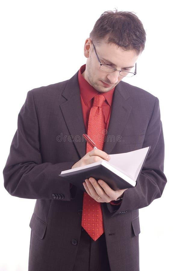Homme d'affaires avec l'ordre du jour photos stock