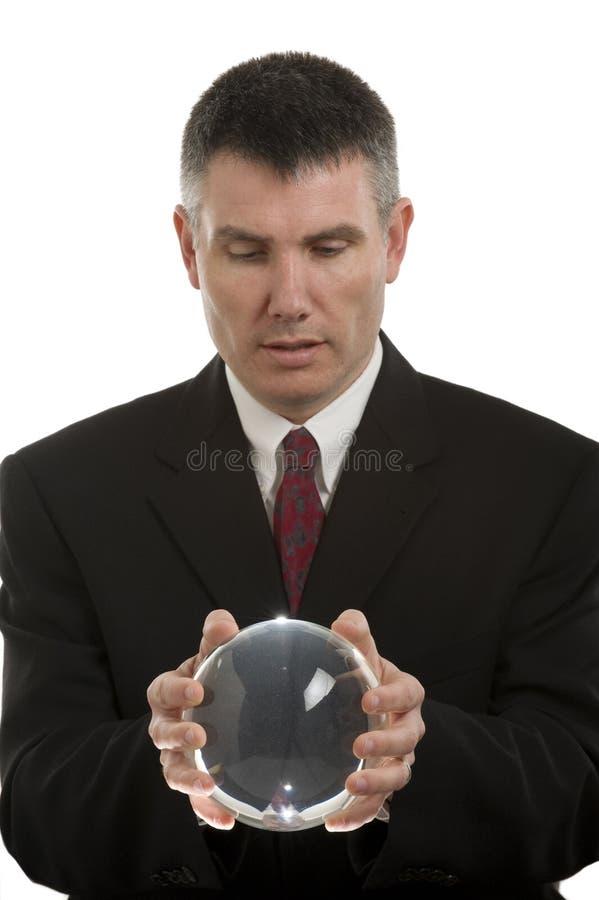 Homme d'affaires avec la bille en cristal photos stock