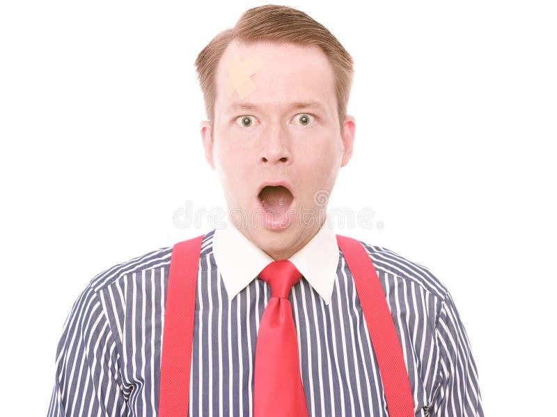 Homme d'affaires avec la blessure à la tête mineure (version choquée) photo stock