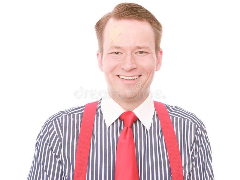 Homme d'affaires avec la blessure à la tête mineure (version heureuse) image libre de droits