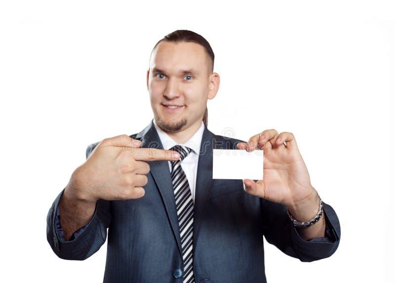 Homme d'affaires avec la carte vierge de visite images stock