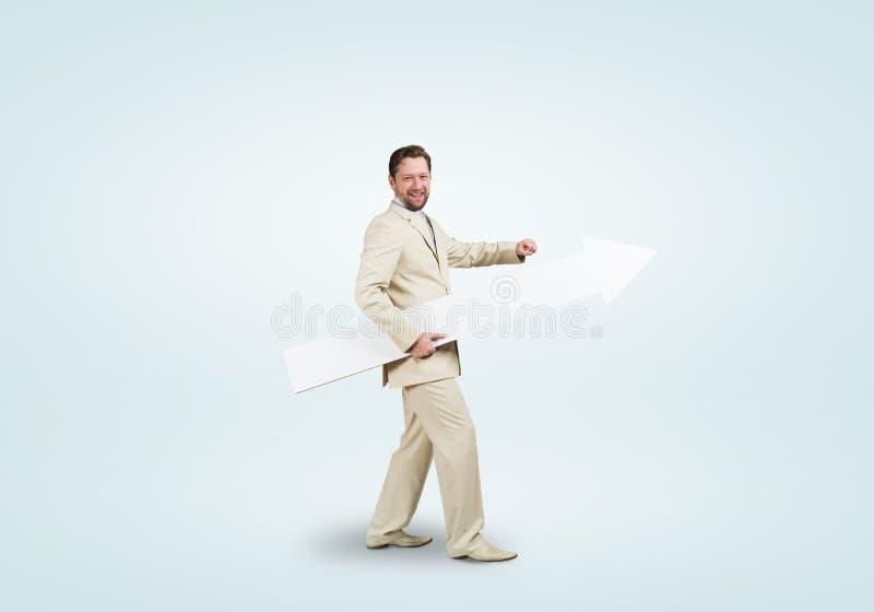 Homme d'affaires avec la flèche photo libre de droits