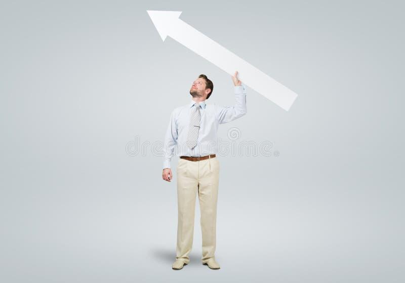 Homme d'affaires avec la flèche photographie stock libre de droits